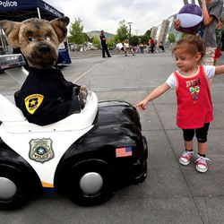 Lili Custer checks out a talking, robotic police dog at Five-O Fest, a free community festival hosted by the Utah Anti-Bullying Coalition, Safe2Help and the Salt Lake City Police Foundation outside of the Public Safety Building in Salt Lake City on Saturday, May 31, 2014.