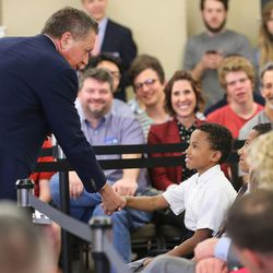 Ohio Gov. John Kasich shakes hands with a group of kids prior to speaking at a Town Hall meeting in the Guest House at the University of Utah Friday, March 18, 2016.