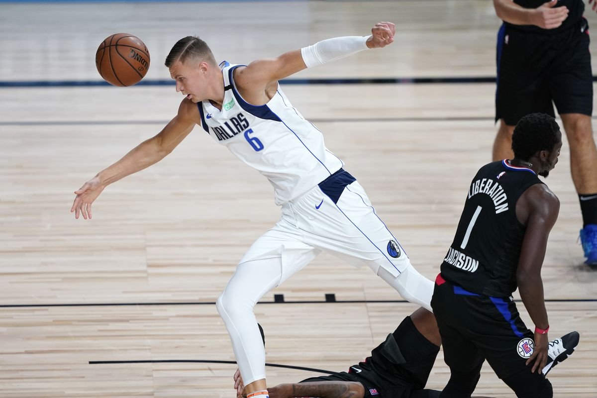Kristaps Porzingis of the Dallas Mavericks stumbles as he chases after the ball during action against the LA Clippers the first half in game two of the first round of the NBA playoffs at AdventHealth Arena at ESPN Wide World Of Sports Complex on August 19, 2020 in Lake Buena Vista, Florida.