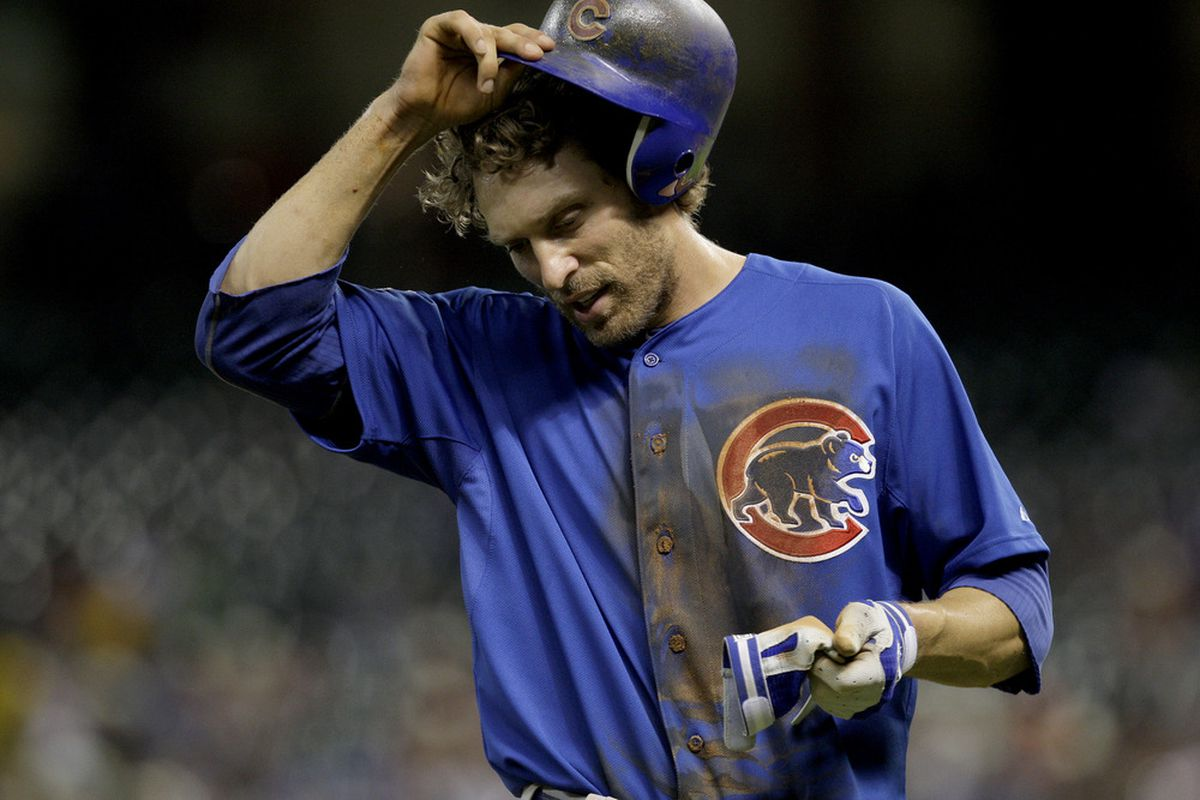 Joe Mather of the Chicago Cubs removes his helmet after he was left on third at the end of the top of  the 6th inning against the Houston Astros at Minute Maid Park in Houston, Texas.(Photo by Thomas B. Shea/Getty Images)