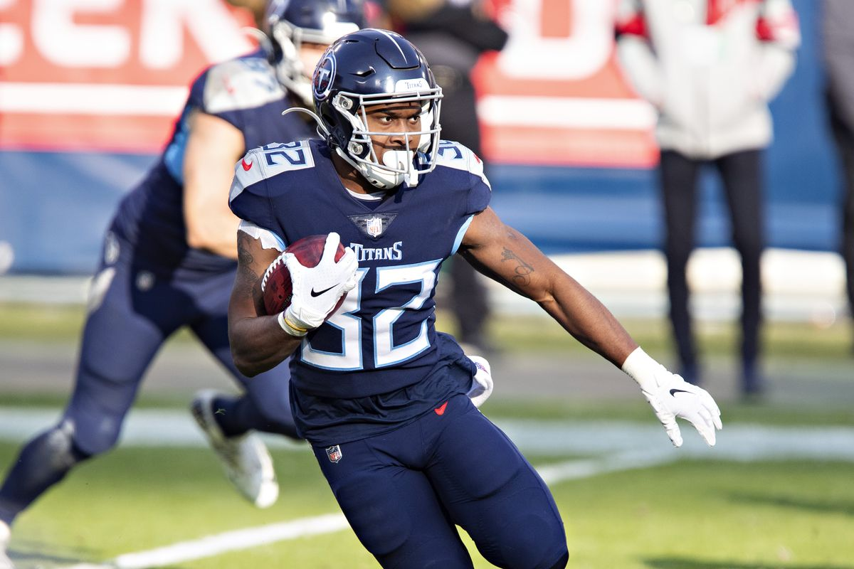 Running back Darrynton Evans #32 of the Tennessee Titans returns a kick off during their AFC Wild Card Playoff game against the Baltimore Ravens at Nissan Stadium on January 10, 2021 in Nashville, Tennessee. The Ravens defeated the Titans 20-13.