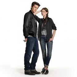 Him: Printed Flag Tee in White, $19.99 Nylon Jacket in Black, $49.99 Straight Jeans in Medium Wash with Oil Stains, $49.99 Her: Tank in Gray, $16.99 Woven Silk Blouse in Black, $34.99 Skinny Jeans with Patches, $49.99