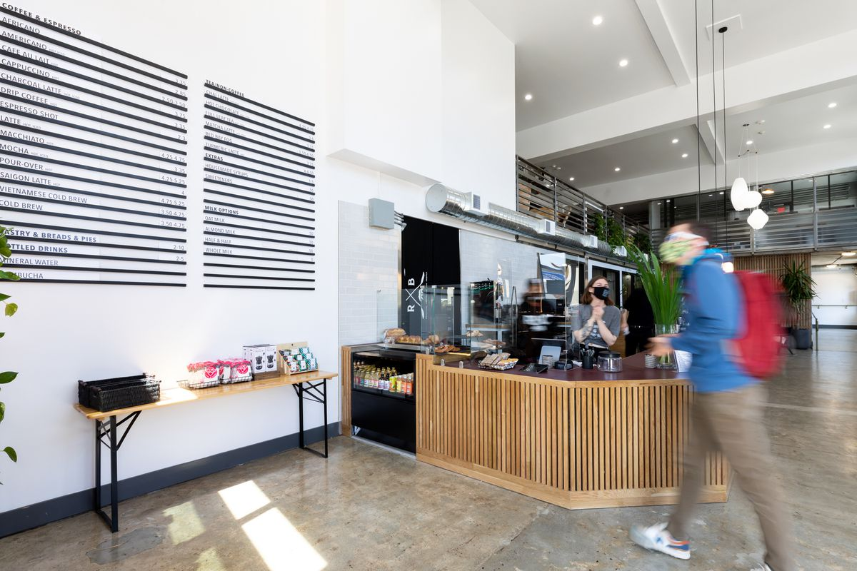 A customer walks up to the coffee bar at Red Bay Coffee's headquarters.