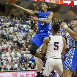 FILE - In this March 4, 2017, file photo, Kentucky guard Malik Monk drives to the basket against Texas A&M guard JC Hampton (5) during the first of an NCAA college basketball game,  in College Station, Texas. Monk is regarded by many as the top shooting guard in Thursday's NBA draft after one year at Kentucky.