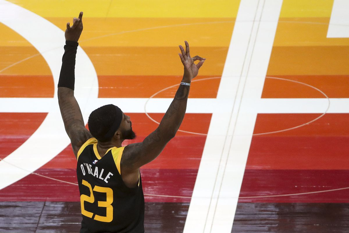 Utah Jazz forward Royce O'Neale (23) signals his thre-pointer late in the fourth quarter during the Philadelphia 76ers at Utah Jazz NBA basketball game at Vivint Smart Home Arena in Salt Lake City on Monday, Feb. 15, 2021.