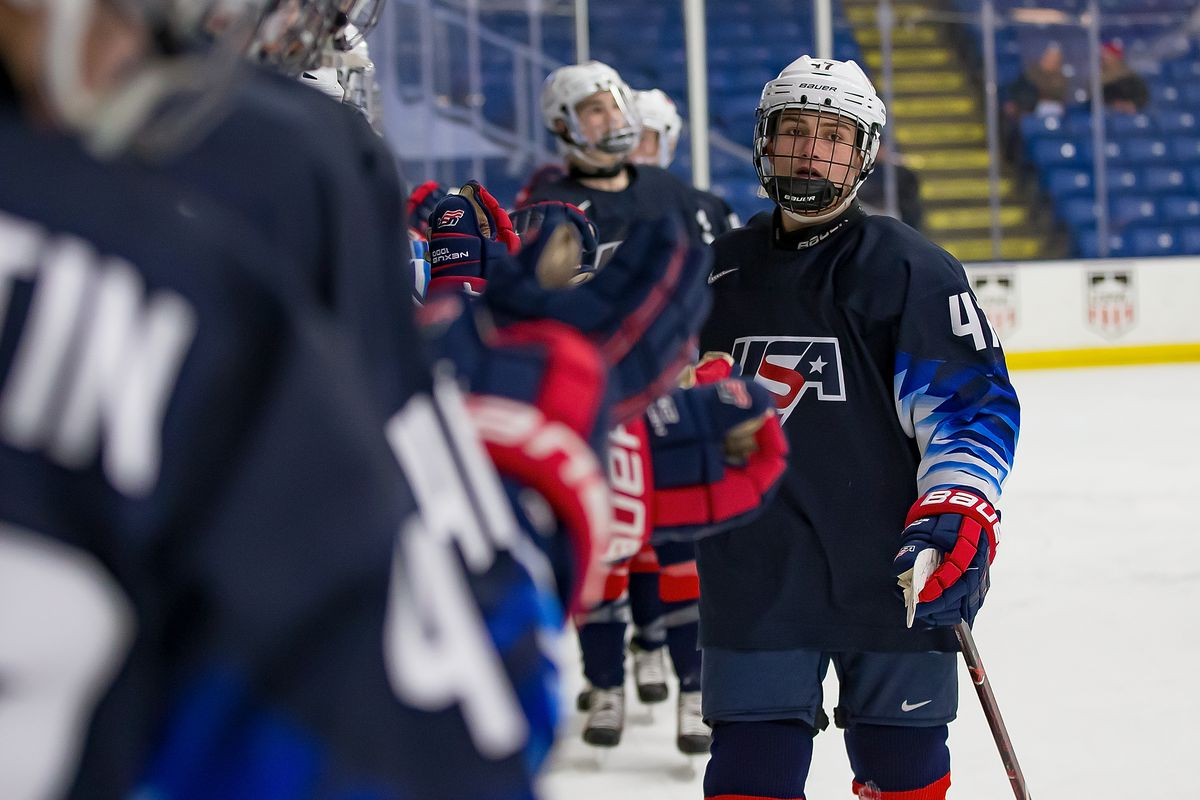 Thomas Bordeleau #47 of the U.S. Nationals celebrates a second period goal with teammates on the bench against the Switzerland Nationals during day-2 of game two of the 2018 Under-17 Four Nations Tournament at USA Hockey Arena on December 12, 2018 in Plymouth, Michigan. USA defeated Switzerland 3-1.
