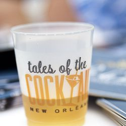 Tales of the Cocktail signature glass and logo for the event.