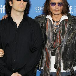 """This image released by Starpix shows Damien Echols, one of the West Memphis Three, left, and actor Johnny Depp at a press conference for the film """"West of Memphis"""" at the 2012 Toronto International Film Festival in Toronto on Saturday, Sept. 8, 2012."""