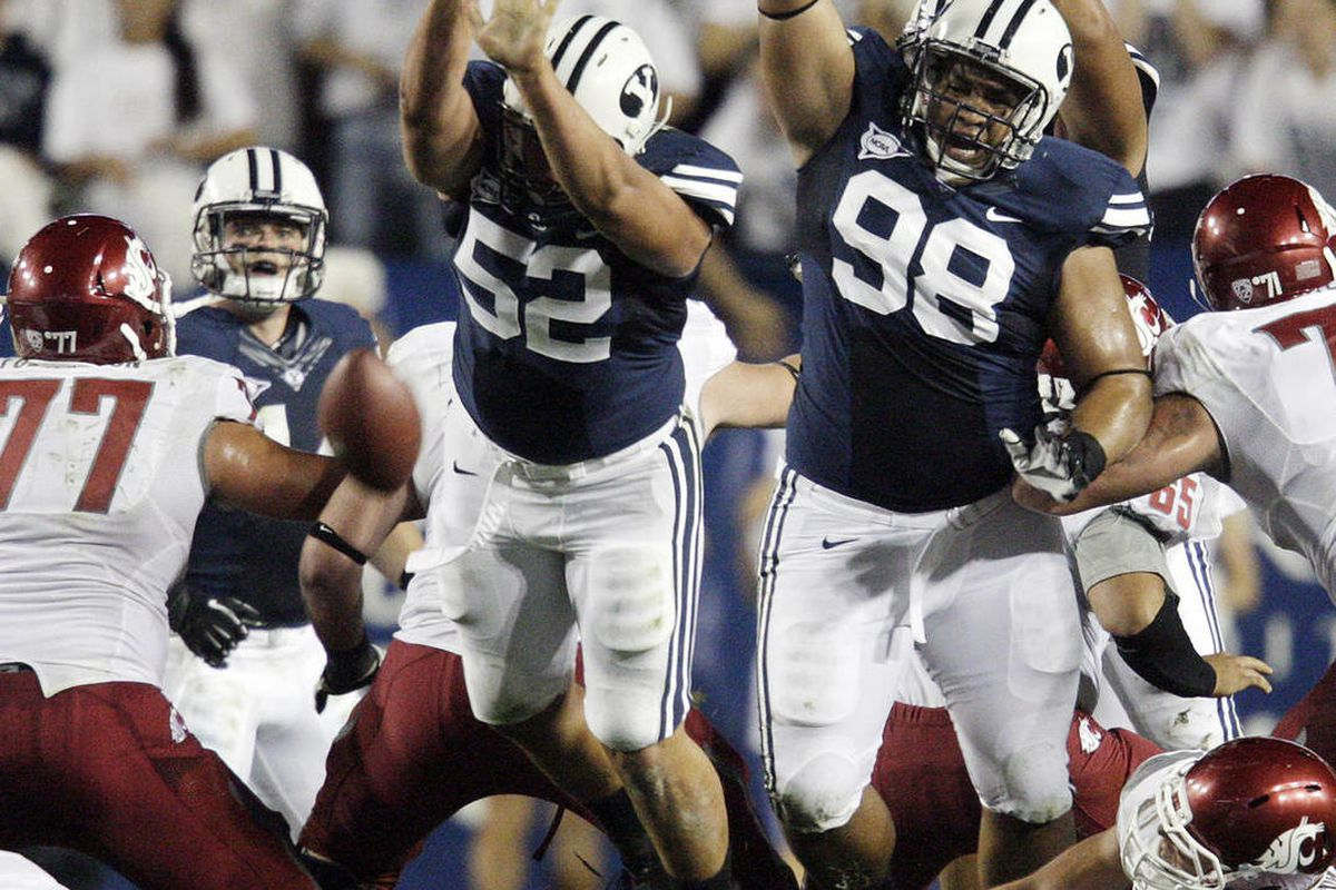 Brigham Young Cougars defensive lineman Russell Tialavea (52) and Brigham Young Cougars defensive lineman Romney Fuga (98) try to block a field gaol attempt  against Washington State in Provo  Thursday, Aug. 30, 2012.
