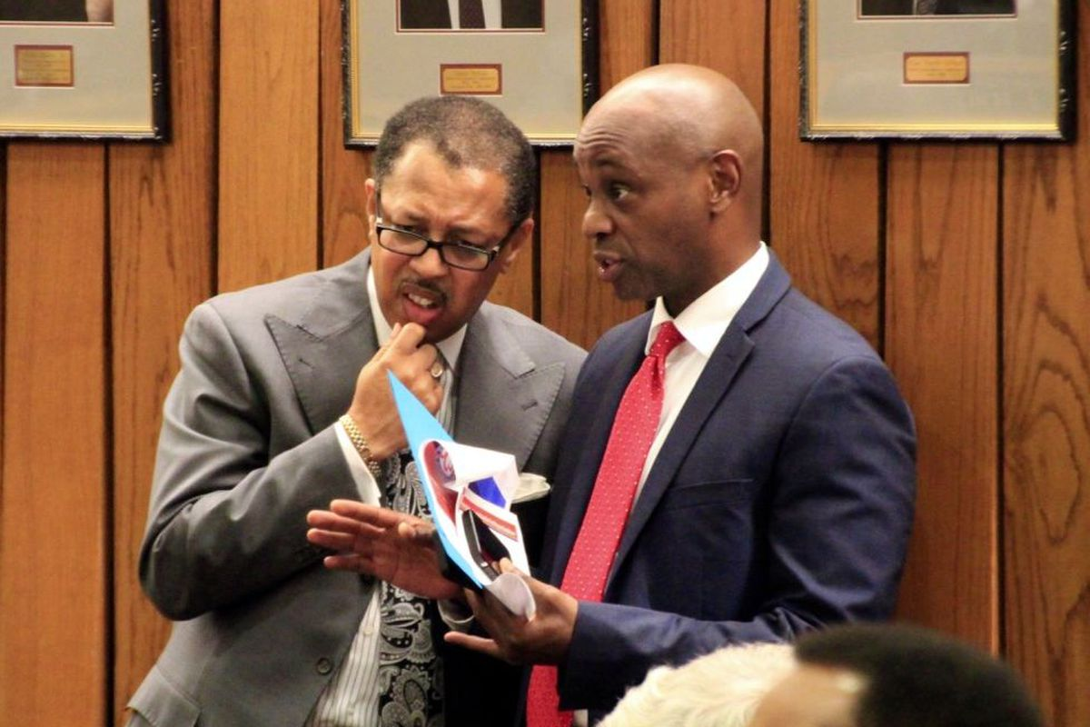 From left: Shelby County Commissioner Willie Brooks and Schools Superintendent Dorsey Hopson confer about education funding in the county's budget in June 2016.
