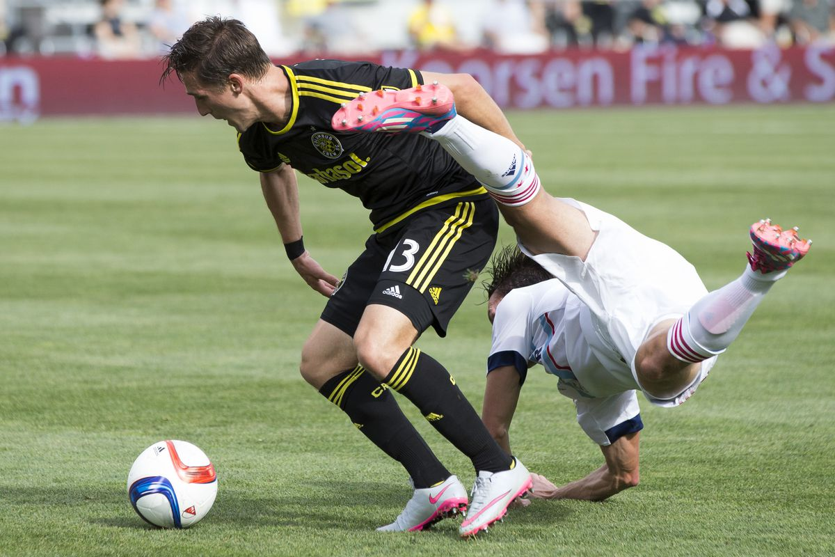 Crew SC's Ethan Finlay controls the ball through contact in a 3-1 win over the Chicago Fire on Sunday in Columbus.
