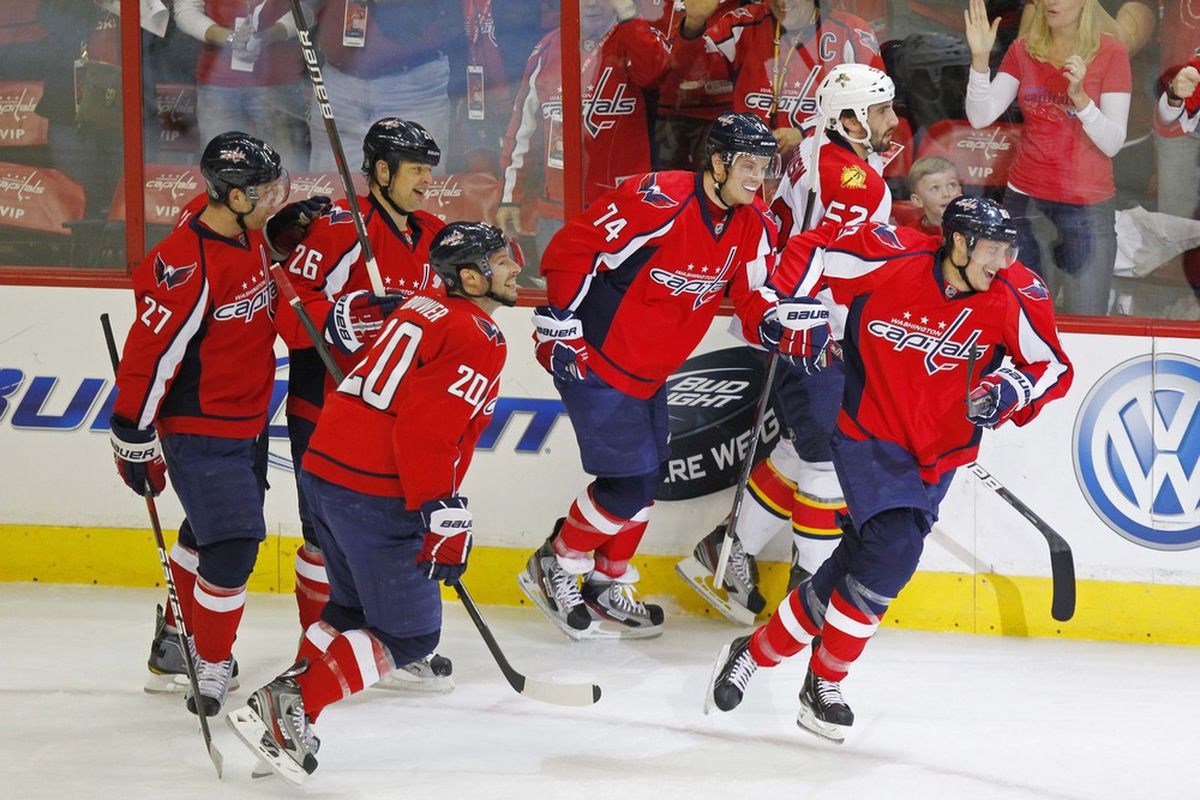April 5, 2012; Washington, DC, USA; Washington Capitals center Jay Beagle (83) celebrates with teammates after scoring a goal against the Florida Panthers in the first period at Verizon Center. Mandatory Credit: Geoff Burke-US PRESSWIRE
