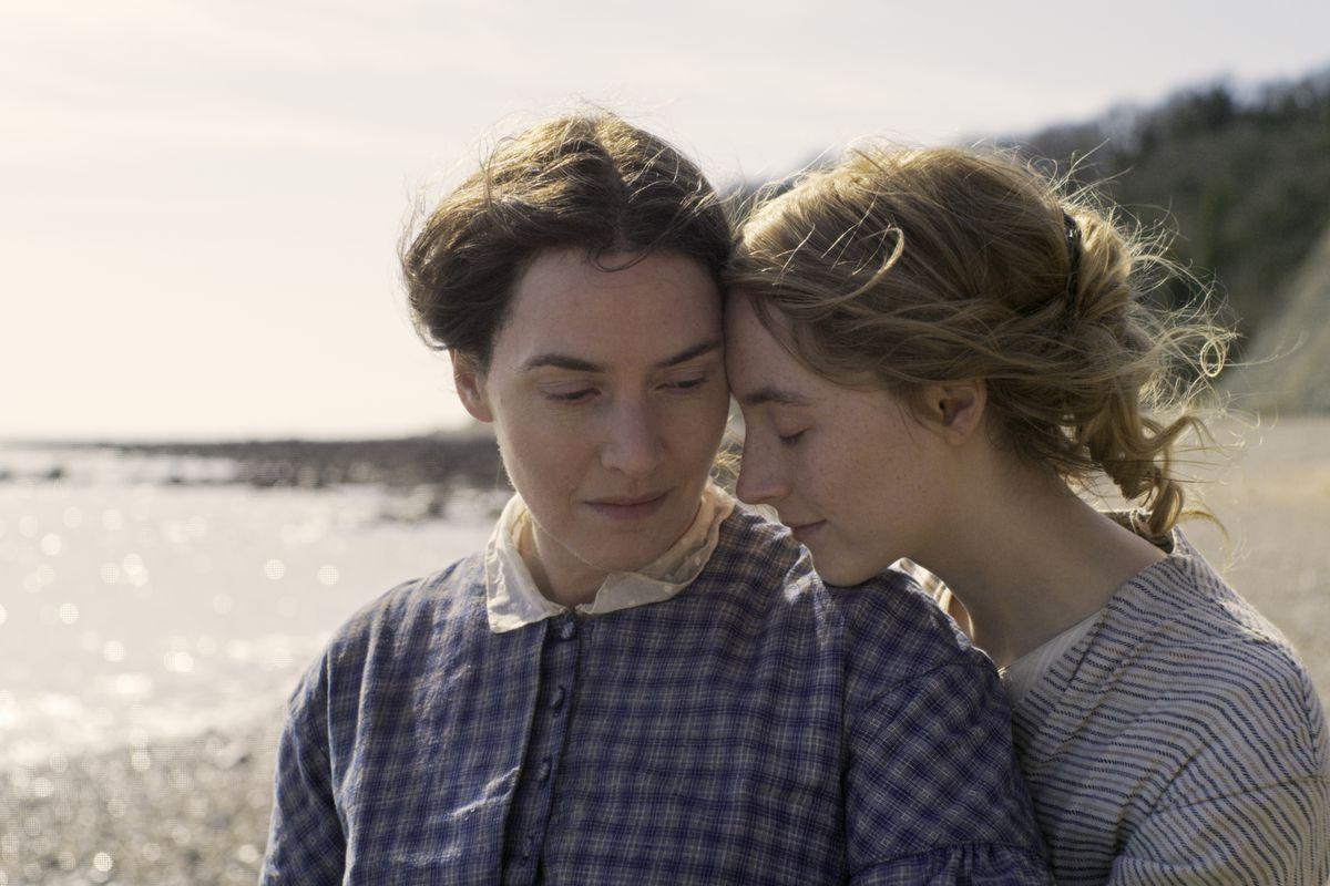 Saoirse Ronan cuddles Kate Winslet on Ammonite Beach