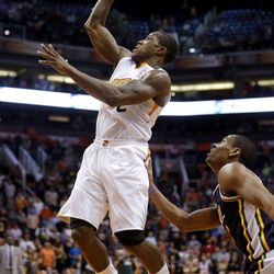 Phoenix Suns' Eric Bledsoe shoots as Utah Jazz guard Alec Burks, right, defends during the second half of an NBA basketball game on Friday, Nov. 1, 2013, in Phoenix. The Suns won 87-84.