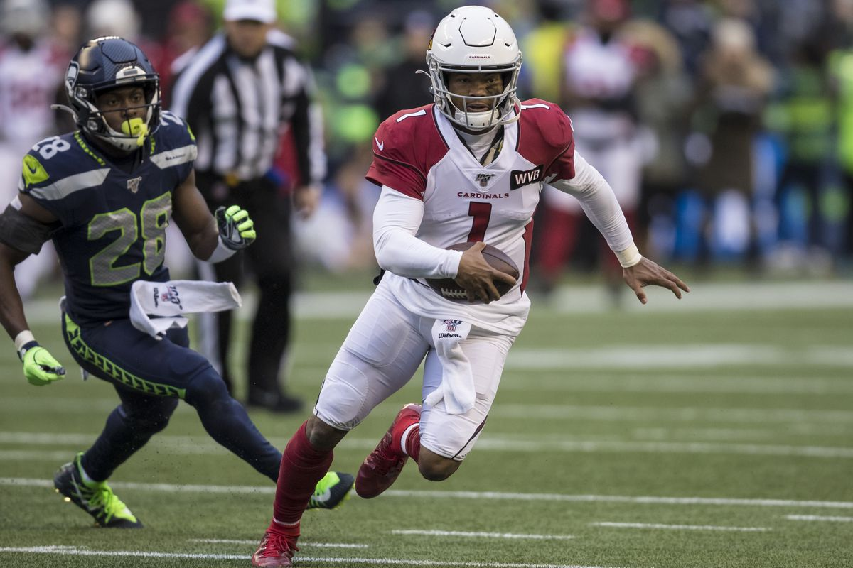 Quarterback Kyler Murray #1 of the Arizona Cardinals scrambles out of the pocket as he is chased by defensive back Ugo Amadi #28 of the Seattle Seahawks during game at CenturyLink Field on December 22, 2019 in Seattle, Washington. The Cardinals won 27-13.