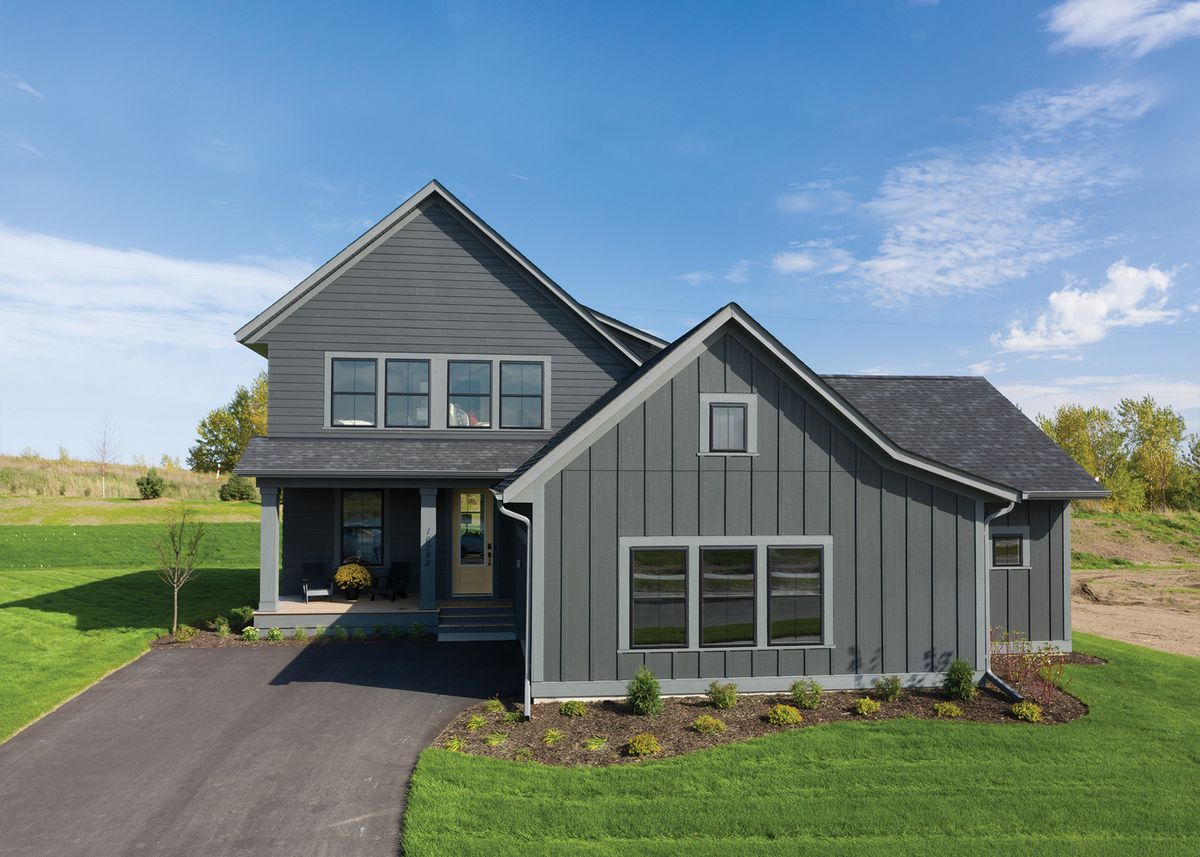 Image of gray farmhouse with mix of lap and board-and-batten siding
