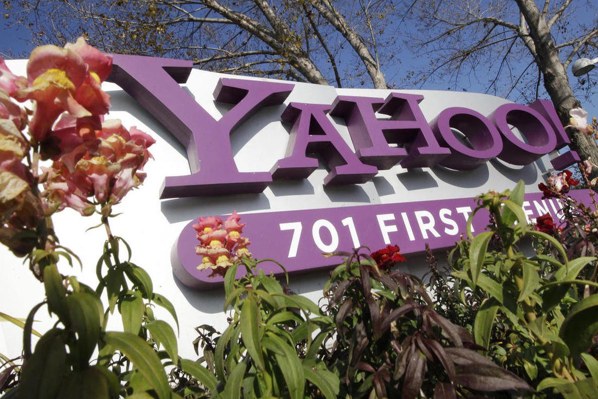 FILE - In this Jan. 4, 2012 file photo, the company logo is displayed at Yahoo headquarters in Sunnyvale, Calif. Yahoo Inc. on Wednesday, April 4, 2012 announced that the company is laying off 2,000 employees as new CEO Scott Thompson sweeps out jobs that