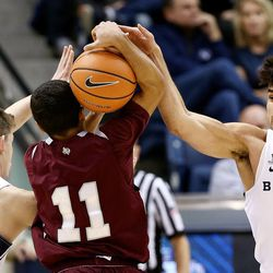 BYU guard McKay Cannon (24) and Cougars guard Elijah Bryant (3) pressure Texas Southern guard Brian Carey (11) as they play an NCAA basketball game in Provo at the Marriott Center on Saturday, Dec. 23, 2017.