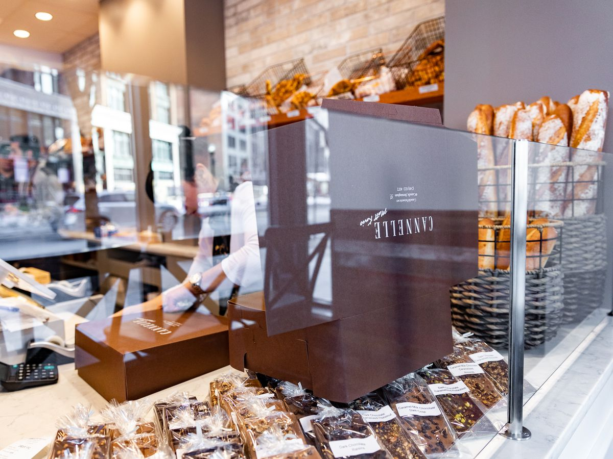 Candy bars and baguettes sit behind a glass window surrounding the counter at Cannelle by Matt Knio.