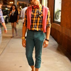 Jamir at Broadway and Broome. He's wearing vintage Lanvin pants, Toms shoes, and a Donna Karan belt.