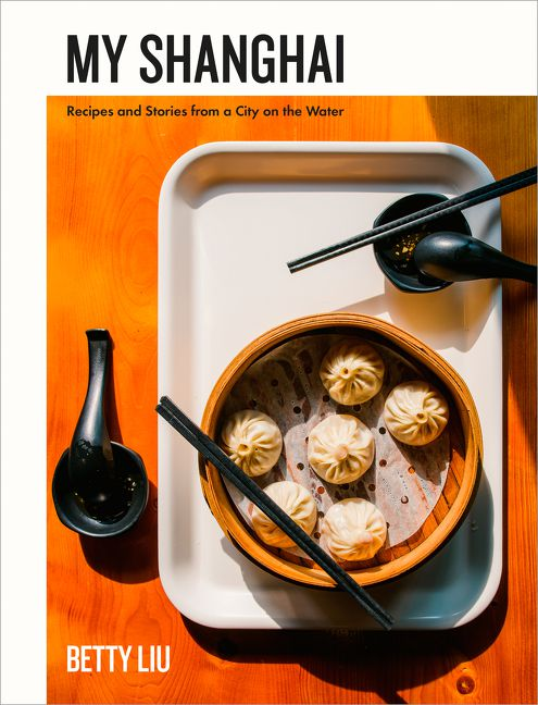 A book cover with a photograph of a steamer basket of soup dumplings on top of a tray