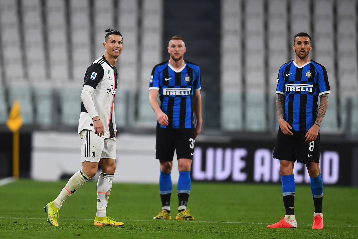 Matias Vecino of FC Internazionale and Cristiano Ronaldo of Juventus look on during the Serie A match between Juventus and FC Internazionale played behind closed doors at Allianz Stadium after the Italian Government has issued a list of new guidelines to help stop the spread of the Coronavirus COVID-19 on March 8, 2020 in Turin, Italy.