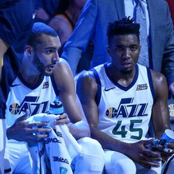 Utah Jazz center Rudy Gobert (27) and guard Donovan Mitchell (45) sit together during a timeout in the game against the Golden State Warriors at Vivint Arena in Salt Lake City on Tuesday, April 10, 2018.