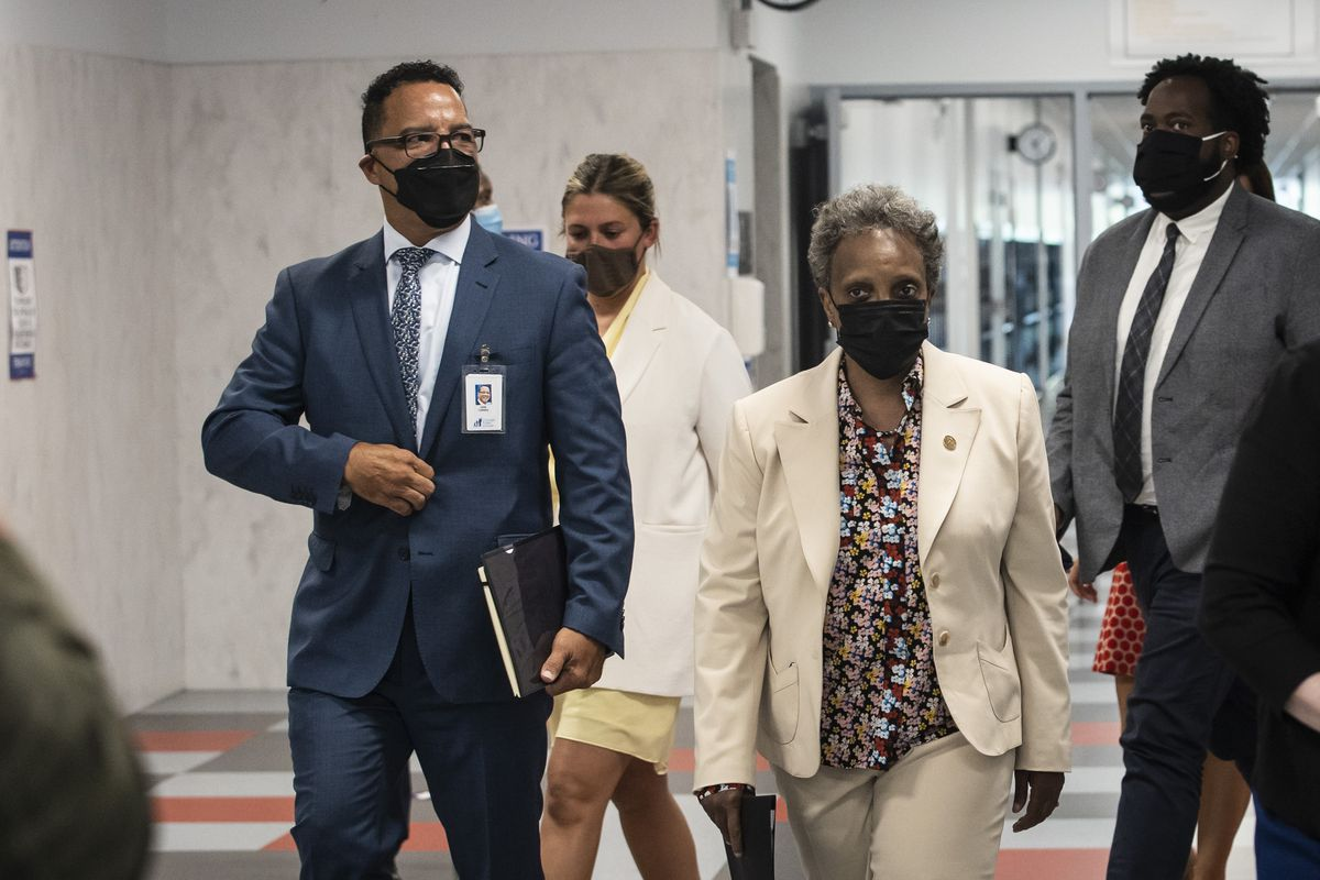 Former Elgin schools superintendent José Torres and Mayor Lori Lightfoot head to a news conference at Richardson Middle School on the Southwest Side, Monday afternoon, June 14, 2021.