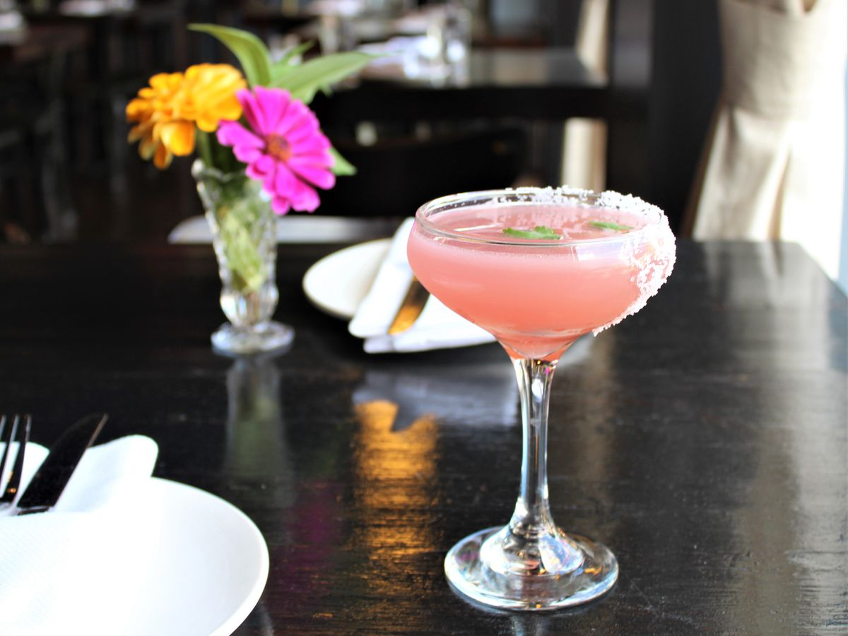 A pink cocktail in a small glass