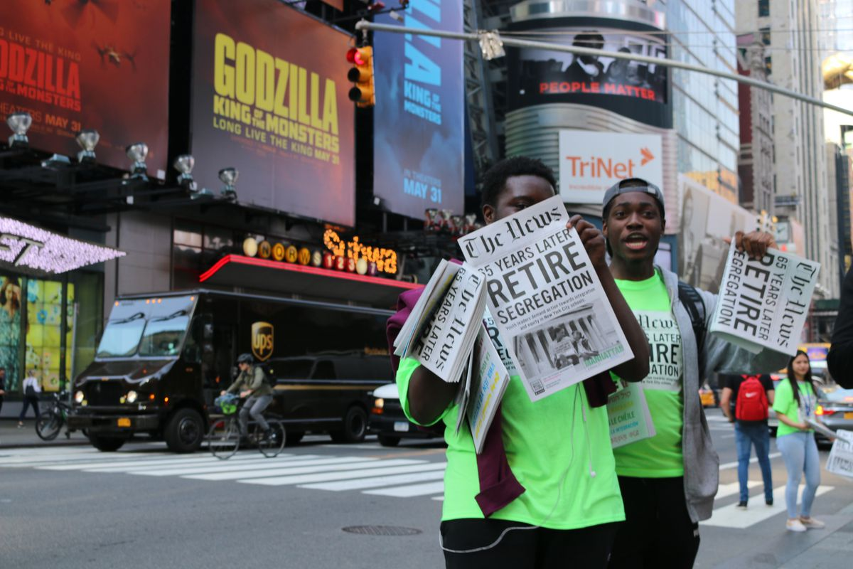Teens with the advocacy group IntegateNYC took to Times Square to hand out newspapers filled with students' own stories about school segregation to mark the anniversary of Brown v. Board of Education. The group is one of many that provided input for the School Diversity Advisory Group recommendations.
