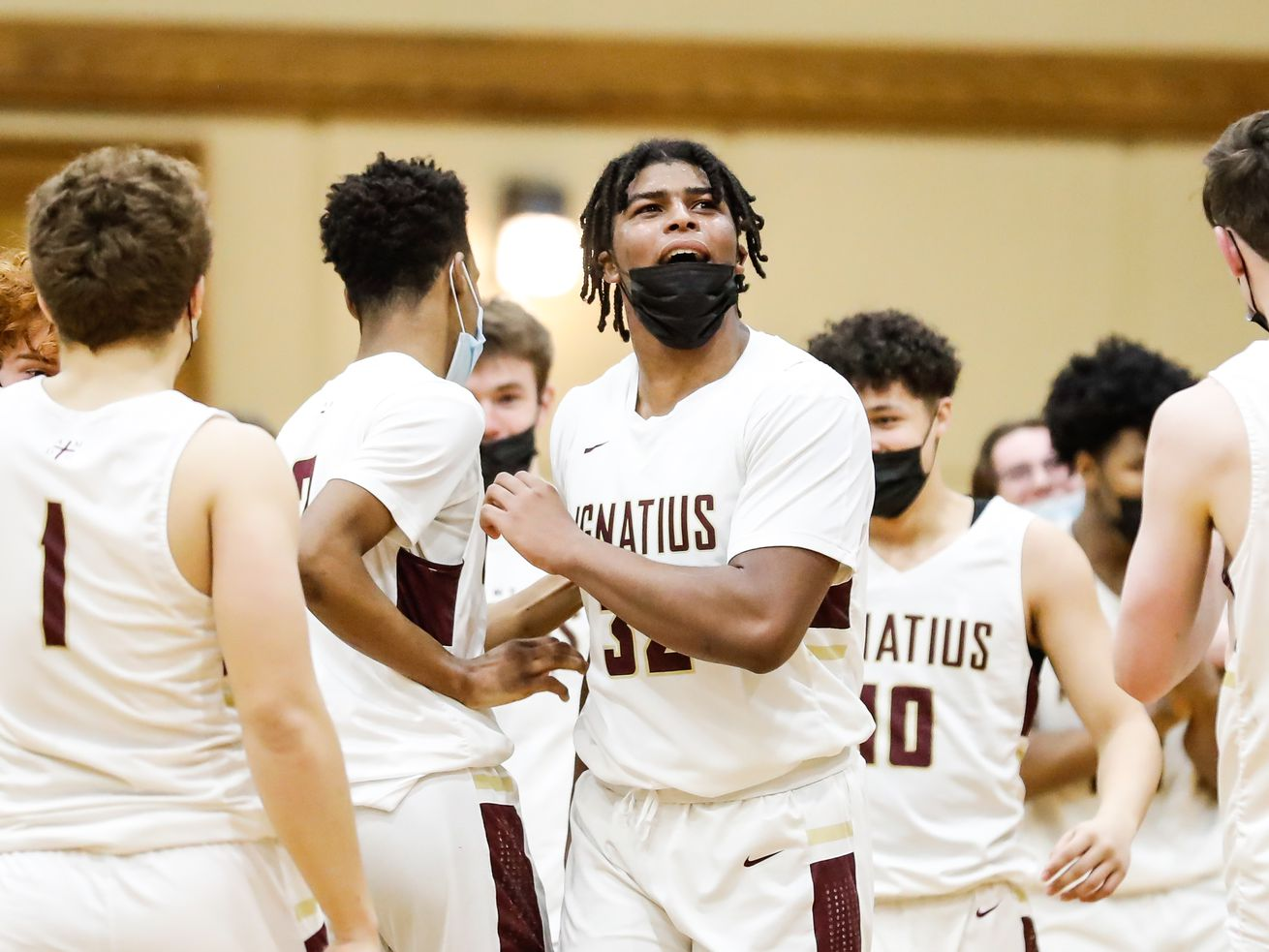 St. Ignatius' Kolby Gilles (32) reacts after winning the game against Curie.