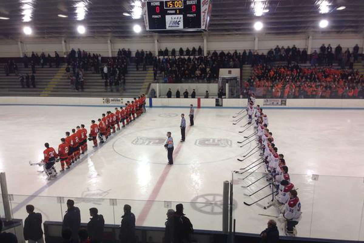 Woburn and Burlington players lined up for the Middlesex League showdown in the MIAA Super 8 Play-in game.
