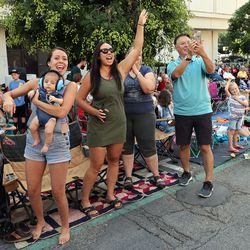 Paradegoers wave and cheer as firefighters pass by during The Days of '47 Parade in Salt Lake City on Friday, July 23, 2021.