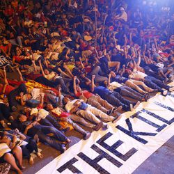 """FILE - In this June 12, 2017, file photo, protesters stage die-in with a banner reading """"Stop the killings"""" during a rally near the Presidential Palace to denounce the Martial Law declaration of President Rodrigo Duterte after Muslim militants laid a siege of Marawi city in southern Philippines for three weeks, in Manila, Philippines. Southeast Asia's jihadis who fought for the Islamic State in Iraq and Syria now have a different battle closer to home in southern Philippines. It's a scenario raising significant alarm in Washington. The recent assault by IS-aligned fighters on the Philippine city of Marawi has left almost 300 people dead, exposing the shortcomings of local security forces and the extremist group's spreading reach."""