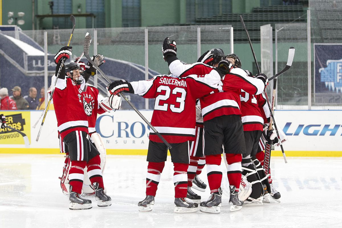 Northeastern players celebrate a goal against UMass Lowell at Fenway Park on January 11, 2014.