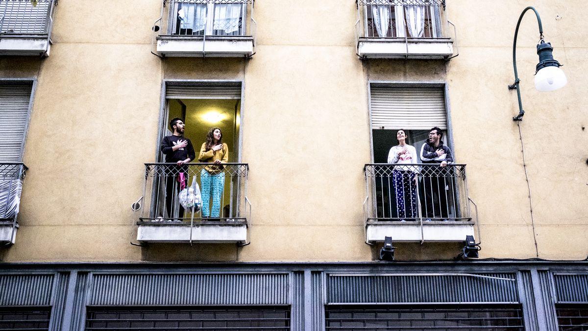 People standing on their balconies.