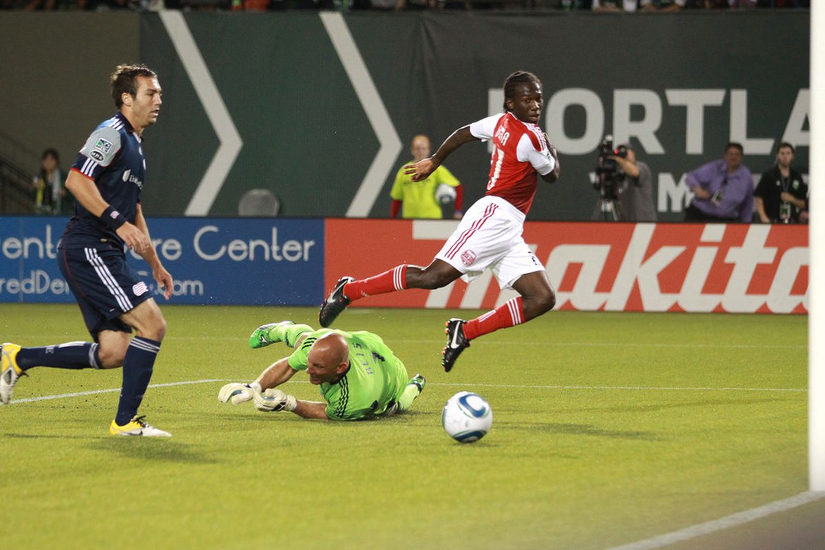 PORTLAND, OR - SEPTEMBER 16: Diego Chara #21 of the Portland Timbers scores a goal against the Matt Reis #1 goalkeeper of New England Revolution  on September 16, 2011 at Jeld-Wen Field in Portland, Oregon. (Photo by Tom Hauck/Getty Images)