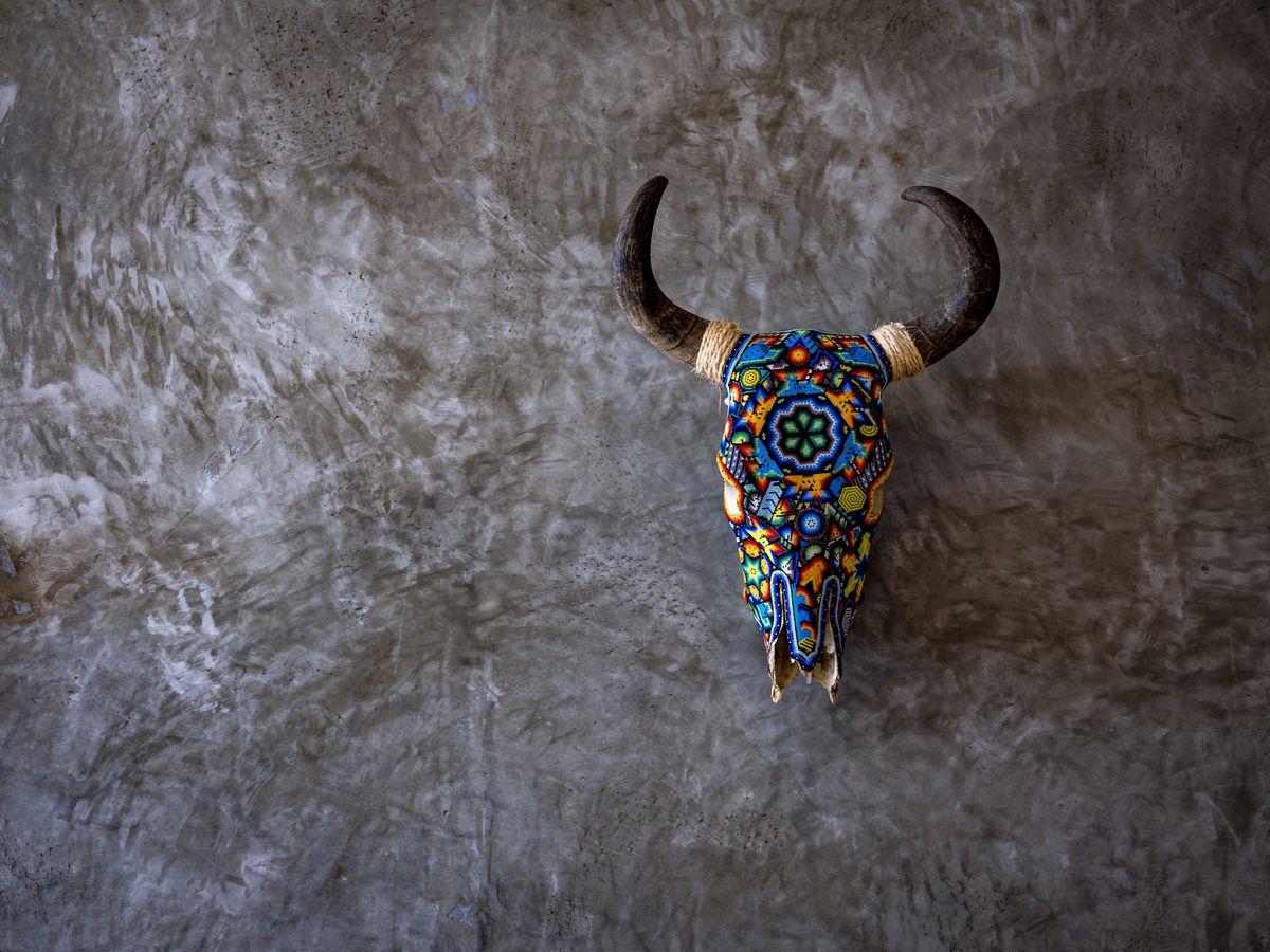 Skull covered in beads at Suerte