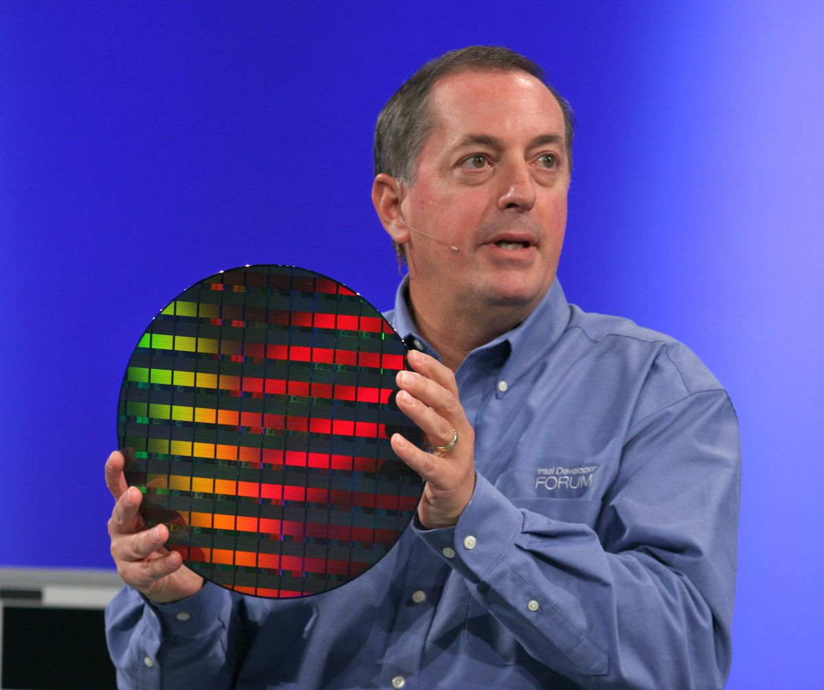 Former CEO Paul Otellini holds up a wafer of chips at the 2006 Intel Developer Forum.