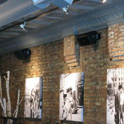 Original tin ceiling and black and white photos warm the space