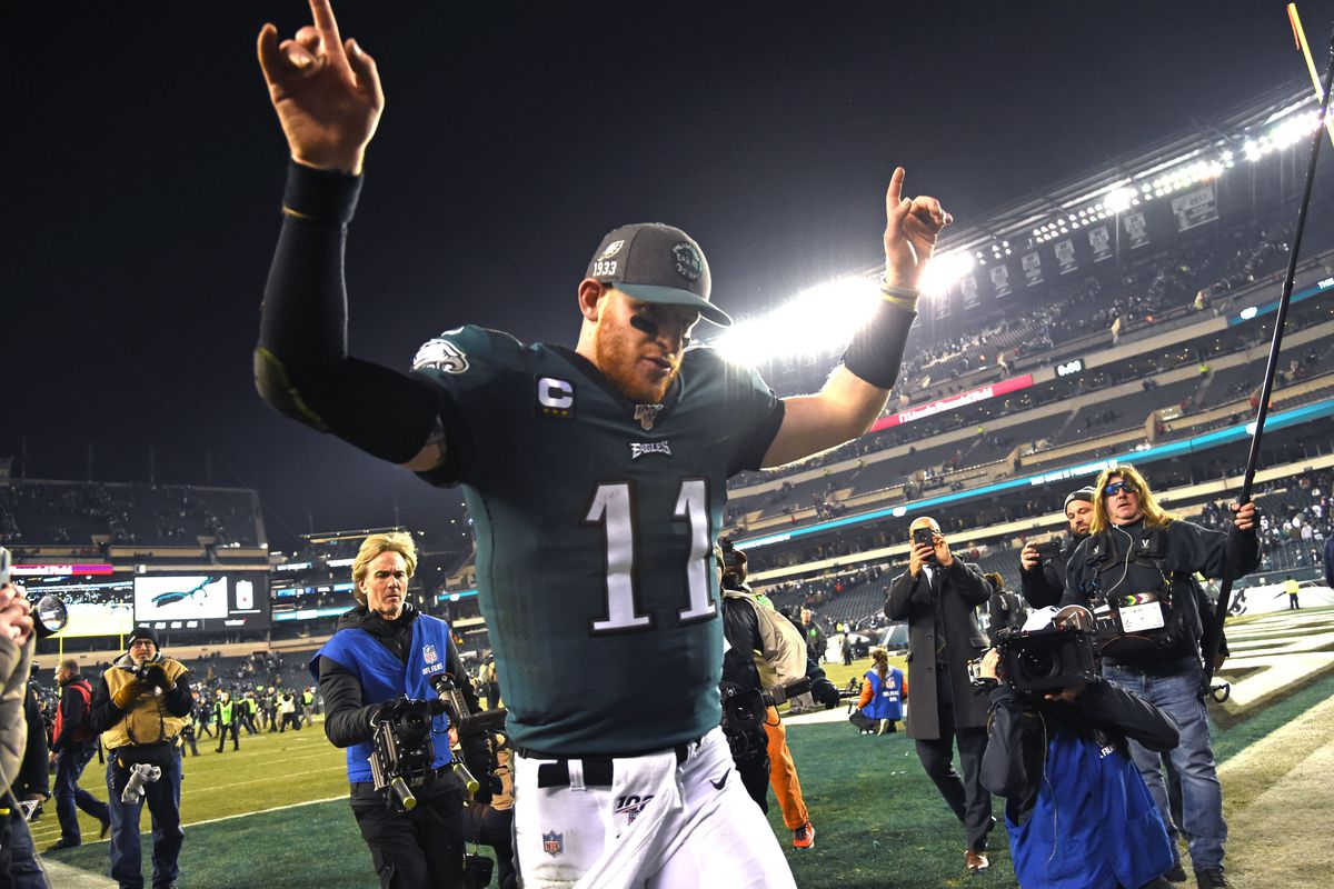 Philadelphia Eagles quarterback Carson Wentz walks off the field after win against the Dallas Cowboys at Lincoln Financial Field.