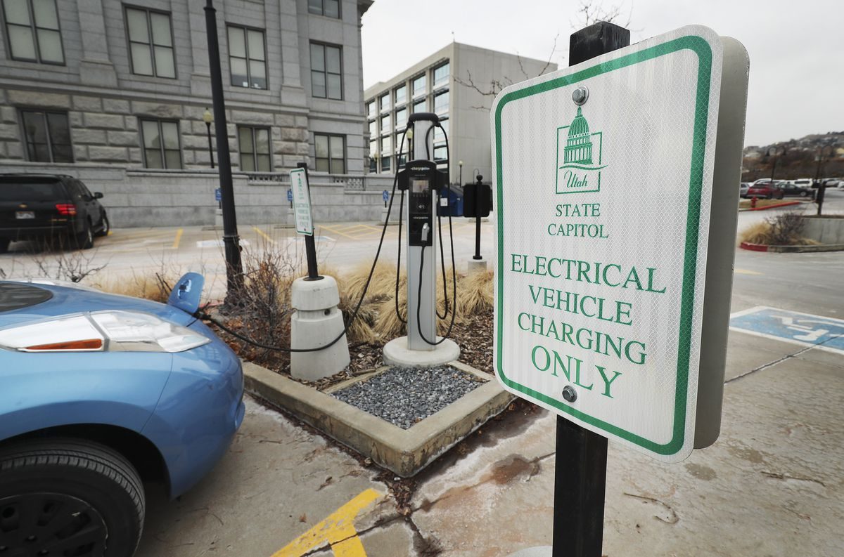 "An electric vehicle is charged at the Capitol in Salt Lake City on Tuesday, Dec. 31, 2019. On New Year's Day, Utah is becoming only the second state in the U.S., after Oregon, to roll out an ongoing and fully operational ""road user charge"" program that electric and hybrid vehicle users can opt in to pay for the miles they drive measured by a device in their car."