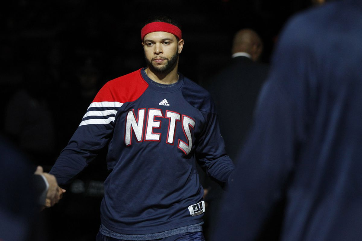 March 31, 2012; Sacramento, CA, USA; New Jersey Nets guard Deron Williams (8) is introduced before the start of the game against the Sacramento Kings at the Power Balance Pavilion. Mandatory Credit: Cary Edmondson-US PRESSWIRE