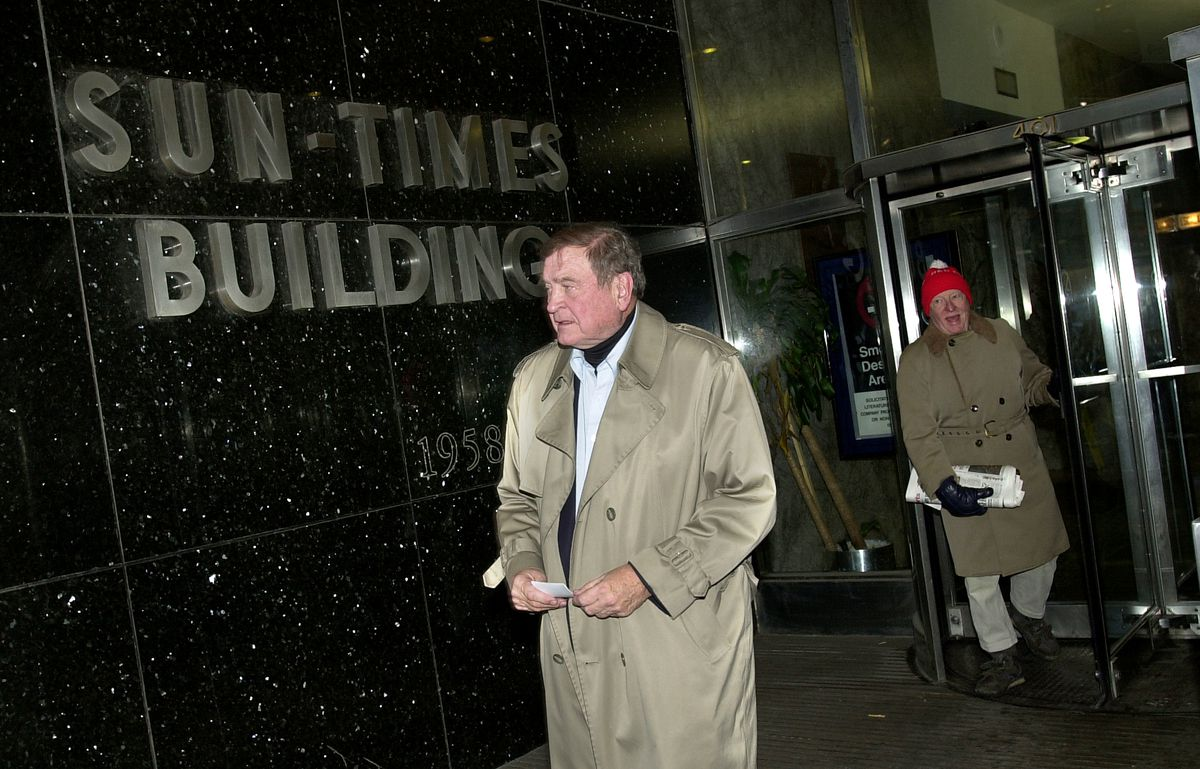 Former Rep. Dan Rostenkowski leaves the old Sun-Times building after taping a segment for FOX News in their studio hours after President Bill Clinton pardoned him in December of 2000. File Photo.