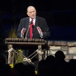 President Thomas S. Monson speaks after being as thousands of scouts and their leaders assemble Tuesday, Oct. 29, 2013 in the Conference Center in Salt Lake City to celebrate a century of honor.