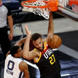 Utah Jazz center Rudy Gobert (27) dunks over Memphis Grizzlies guard De'Anthony Melton (0) as the Utah Jazz and Memphis Grizzlies play Game 2 of their NBA playoffs first round series at Vivint Arena in Salt Lake City on Wednesday, May 26, 2021.