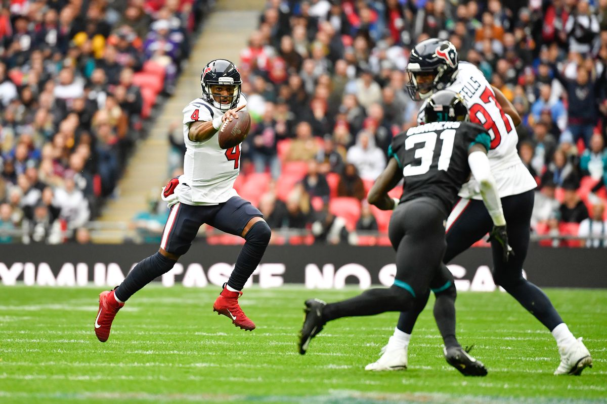 Houston Texans quarterback Deshaun Watson looks downfield for Houston Texans defensive end Angelo Blackson during the first quarter of the game between the Jacksonville Jaguars and the Houston Texans during a game at Wembley Stadium in London, England.