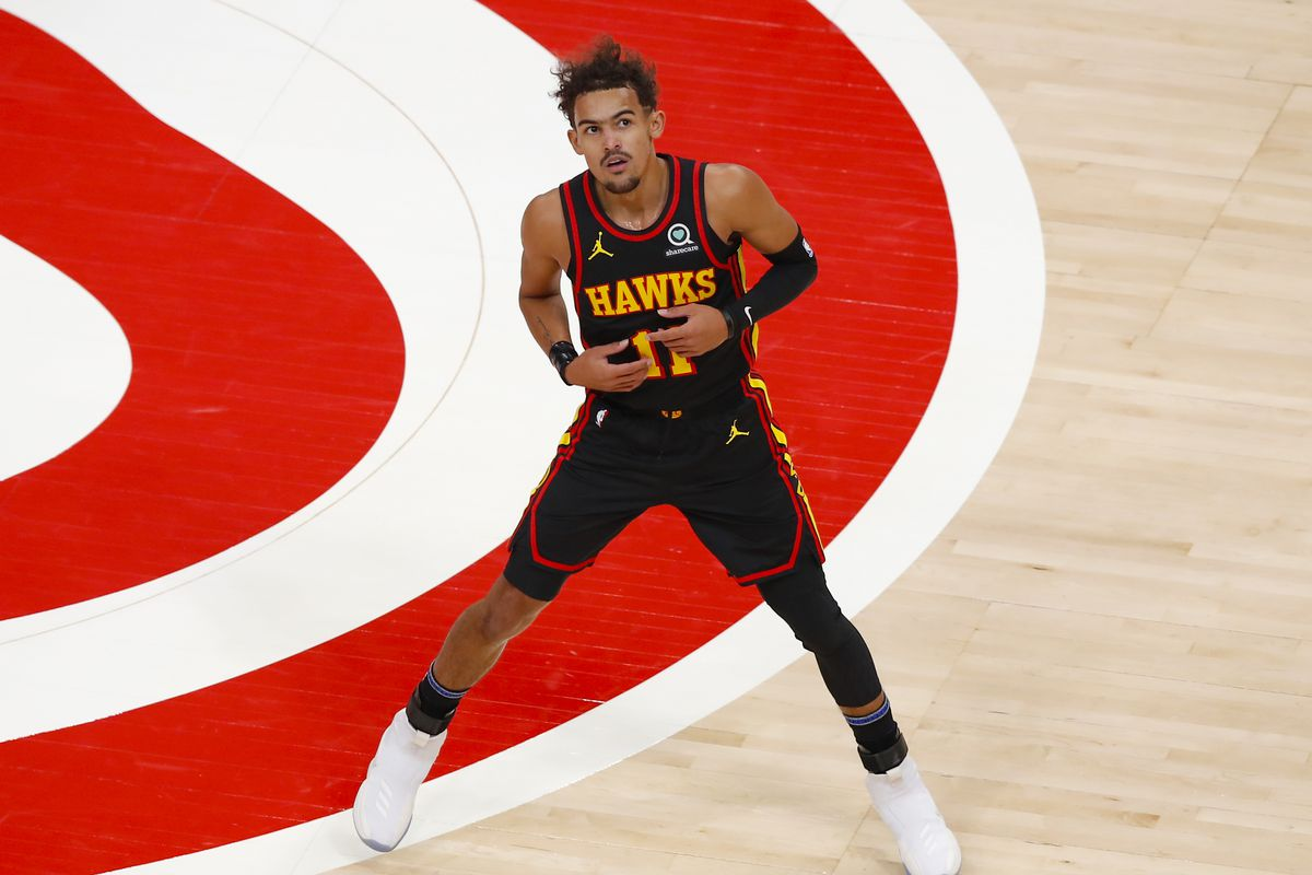 Trae Young of the Atlanta Hawks reacts during the first half against the Philadelphia 76ers at State Farm Arena on January 11, 2021 in Atlanta, Georgia.