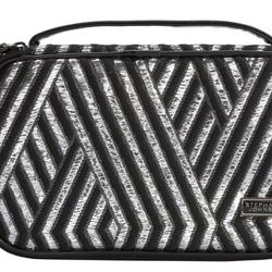 """Stephanie Johnson Grace Brush Case in Wilshire, <a href=""""http://www.stephaniejohnson.com/products.asp?p_id=67&s1_id=323"""">$60</a>. """"For quick'ish trips, I cannot survive without this practical beauty tote. I love that I can tuck brushes and pencils in the"""