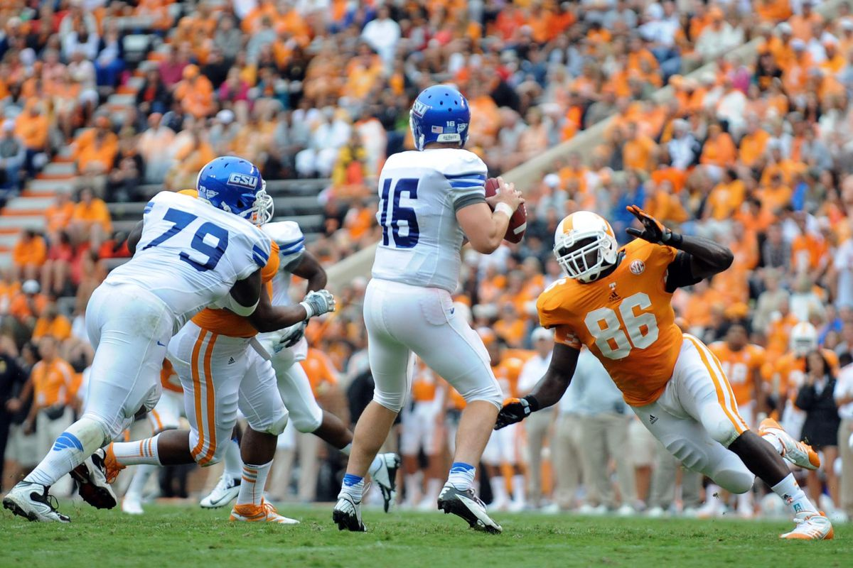 Sep 8, 2012; Knoxville, TN, USA;  Tennessee Volunteers linebacker Willie Bohannon (86) applies pressure to Georgia State Panthers quarterback Ben McLane (16) during the second quarter at Neyland Stadium. Mandatory Credit: Randy Sartin-US PRESSWIRE